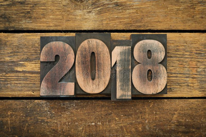 2018 written with vintage letterpress type stock photo