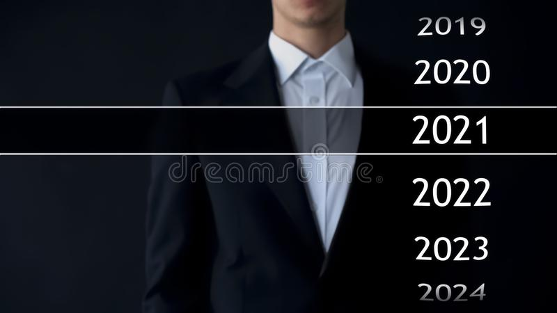 2021 year in virtual archive, businessman on background collection of statistics stock photography