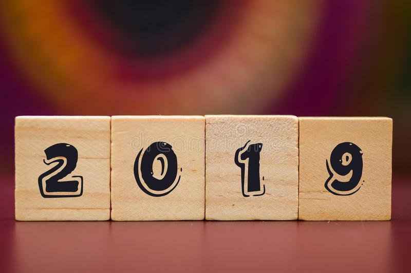 2019 on Wood cubes against colorful background royalty free stock images