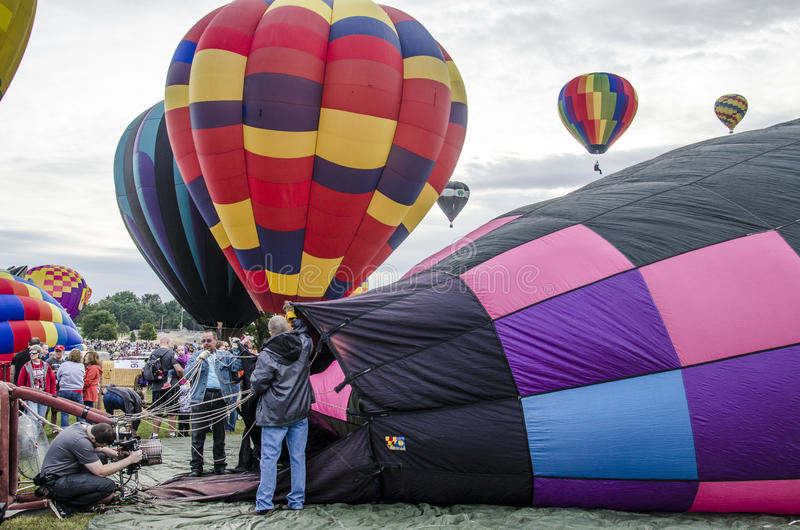 Yearly Balloon Festival Colorado Springs, Colorado. Brightly colored hot air balloons being prepared before take off at the Colorado Springs Memorial Park Lake stock image