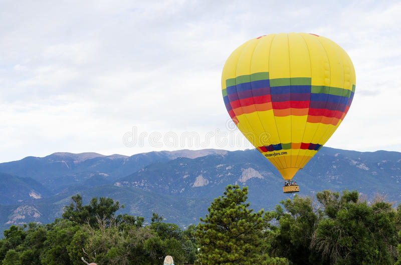 Yearly Balloon Festival Colorado Springs, Colorado. Brightly colored hot air balloons being prepared before take off at the Colorado Springs Memorial Park Lake royalty free stock photography