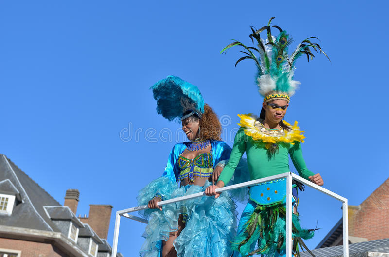 Yearly carnival in Nivelles, Belgium. NIVELLES, BELGIUM-MARCH 03, 2014: Unidentified happy participants of parade in defile during yearly carnival in Nivelles stock images