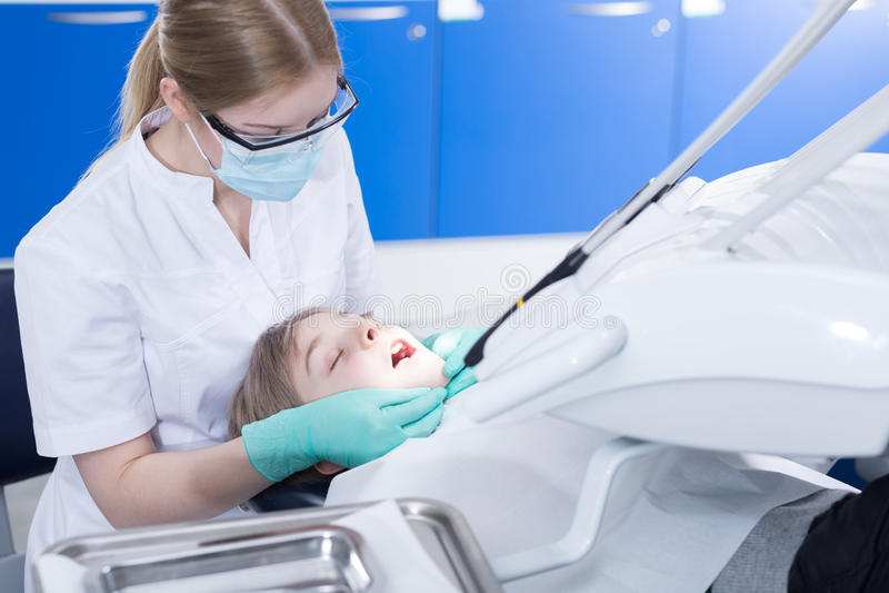 Yearly checkup at a dental office royalty free stock image