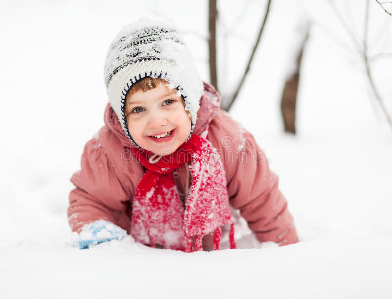 2 years baby girl in winter park. Portrait of happy 2 years baby girl in winter park stock photography