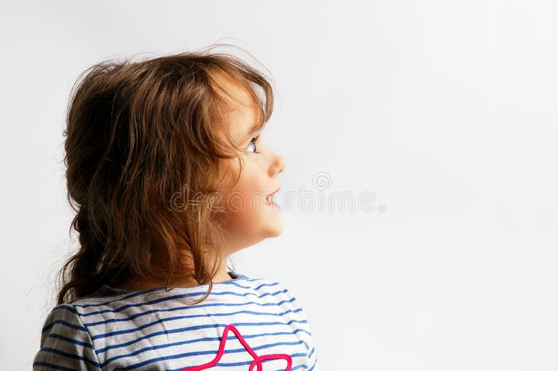 3-4 years little girl looking up stock photo