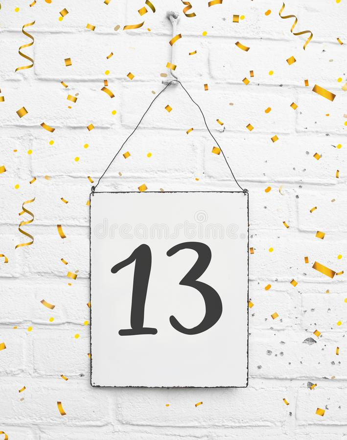 13 years old birthday party card with number thirteen with golden confetti royalty free stock photography