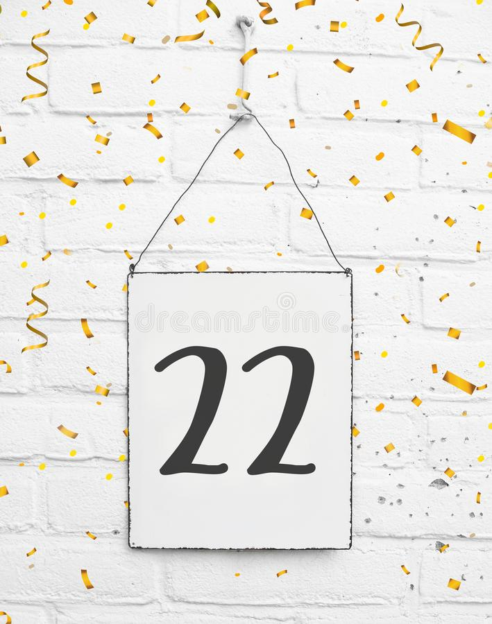 22 years old birthday party card with number twenty two with golden confetti stock photos