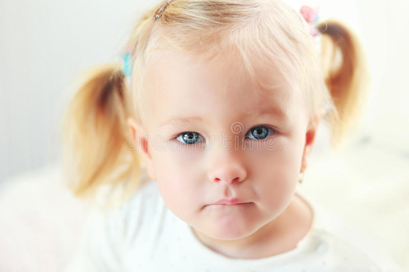 2 years old girl. Close up portrait of adorable 2 years old girl royalty free stock image