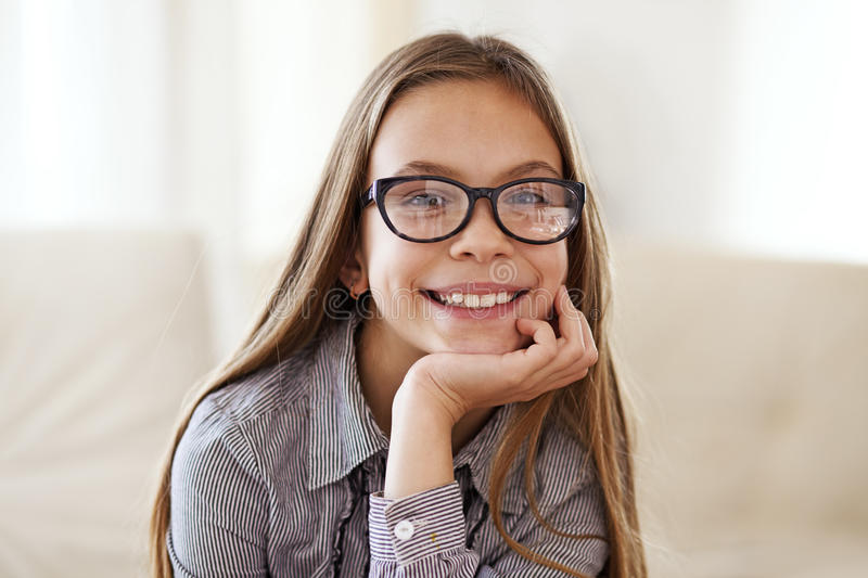 8 years old girl. Portrait of 8 years old school girl wearing glasses looking at camera stock image