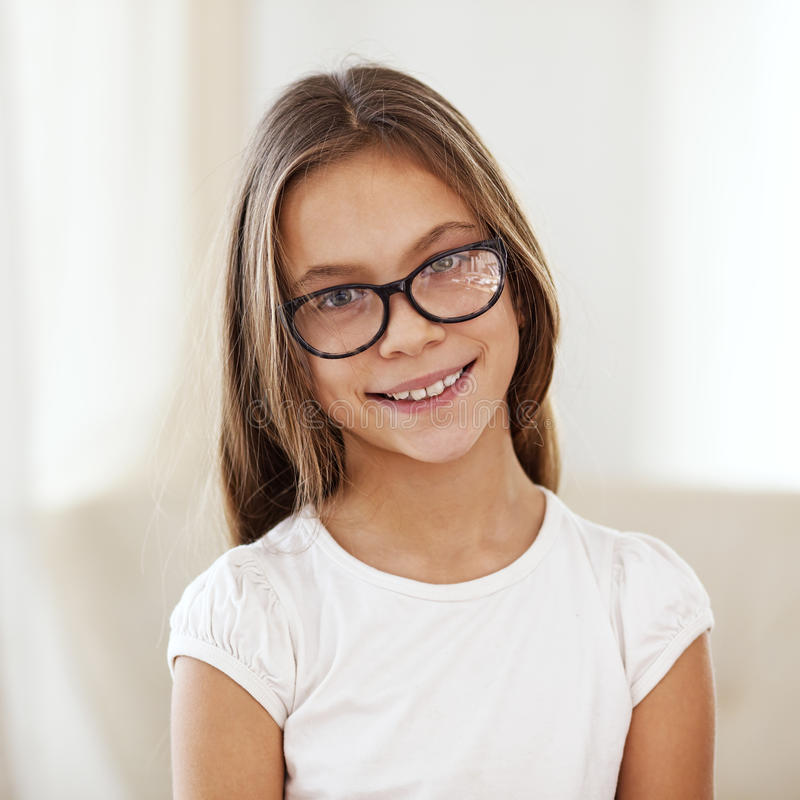 8 years old girl. Portrait of 8 years old school girl wearing glasses looking at camera stock photos