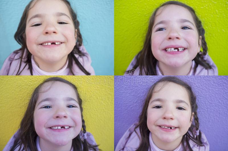 6 years old girl showing her first baby incisor fallen out. Four shots with different backgrounds royalty free stock image