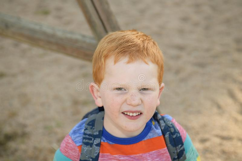 5 years old redheaded happy boy portrait. He is looking at camera royalty free stock photo