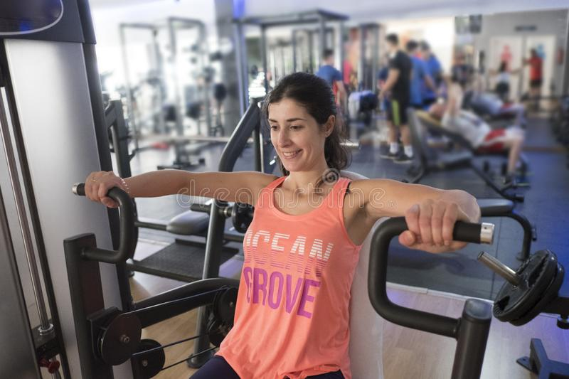 Woman training in gym with weights royalty free stock photo