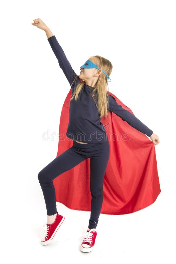 7 or 8 years old young female schoolgirl child in super hero costume performing happy and excited isolated on white background stock photos