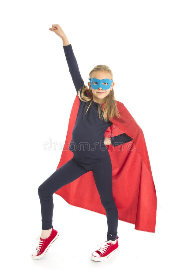 7 or 8 years old young female schoolgirl child in super hero costume performing happy and excited isolated on white background stock images