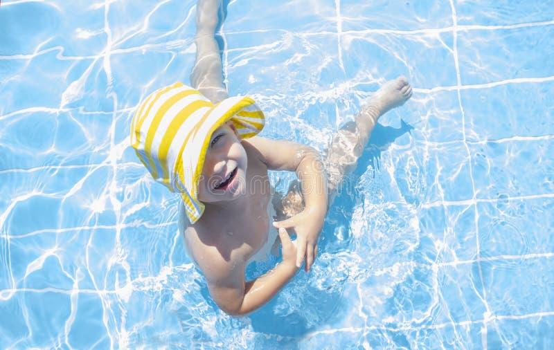 3 years toddler boy enjoying swimming pool at shallow area royalty free stock images
