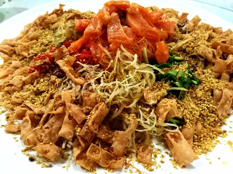 Yee Sang Prosperity Toss. Yusheng, yee sang or yuu sahng, or Prosperity Toss, also known as lo hei is a Teochew-style raw fish salad stock photography