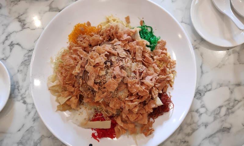 Yee sang or yusheng dish during Chinese New Year stock photos