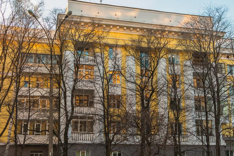 Yekaterinburg, Sverdlovsk Russia - 11 11 2018: The beautiful yellow historic building with white columns and balconies and reflect stock photos