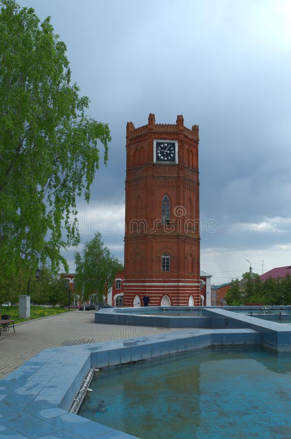 YELETS / LIPETSK, RUSSIA - MAY 08, 2017: old water tower with clock 1872. One of the main attraction royalty free stock images
