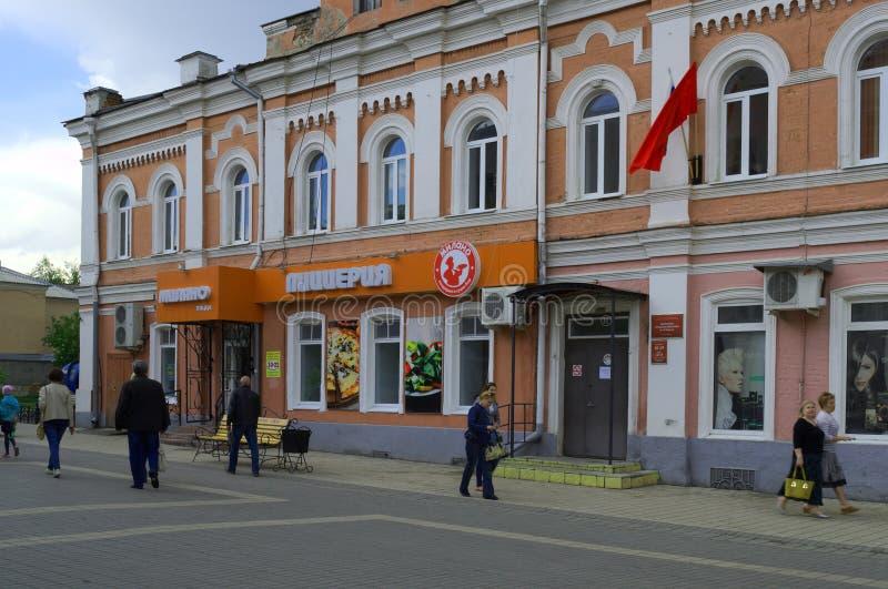 YELETS / LIPETSK, RUSSIA - MAY 08, 2017: people walk along the city street past the pizzeria. YELETS / LIPETSK, RUSSIA - MAY 08, 2017: people walk along the city stock photography