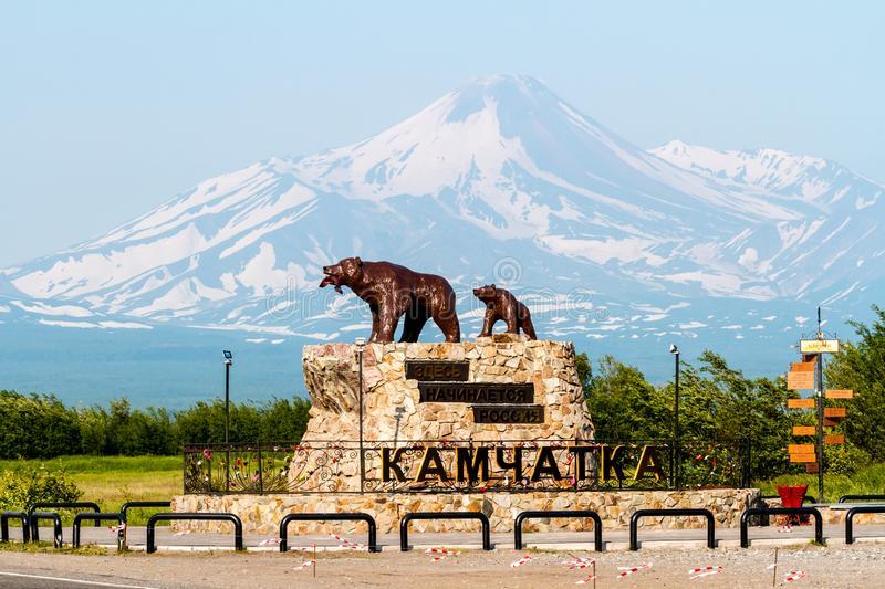 Monument `She bear with the cub` on the background of the Avachinsky Volcano. Caption: `Here begins Russia`. stock image