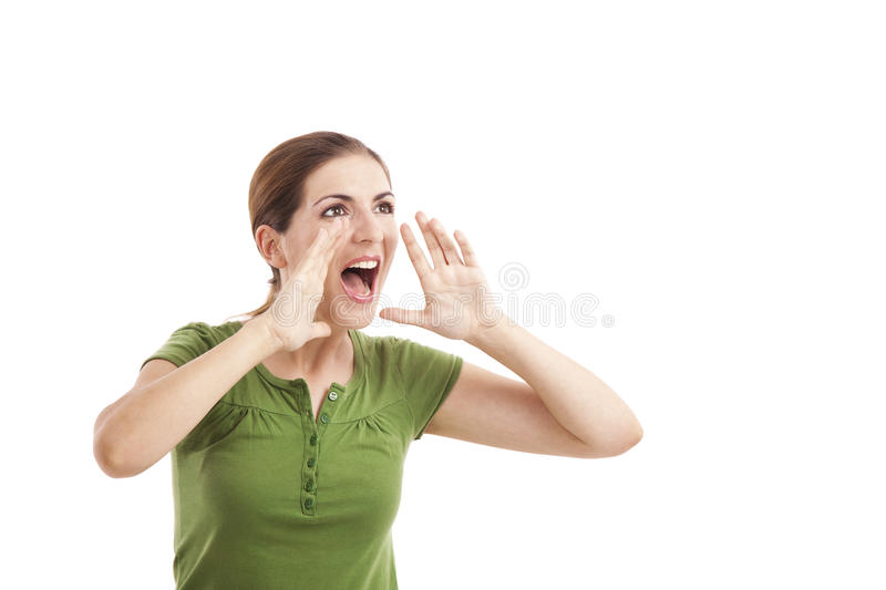 Yelling. Portrait of a young woman yelling with hands on the mouth, isolated on white background royalty free stock photography