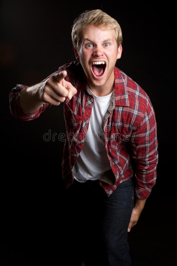 Yelling Pointing Man. Angry yelling pointing young man royalty free stock photo