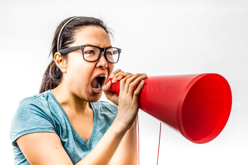 Yelling women. Asian woman yelling in amplifier royalty free stock image