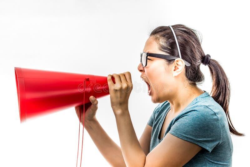 Yelling women. Asian woman yelling in amplifier royalty free stock photos