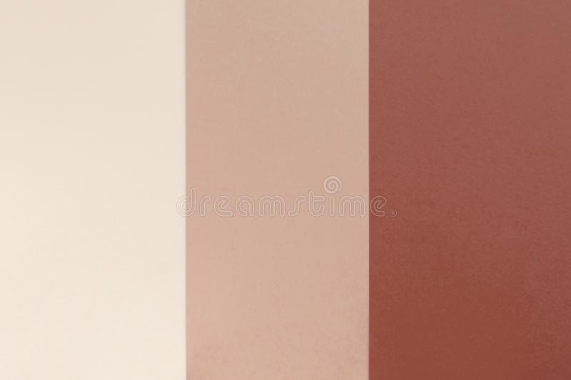 Beige brown blue paper background. Geometric flat composition. Empty space on monochrome cardboard royalty free stock photos