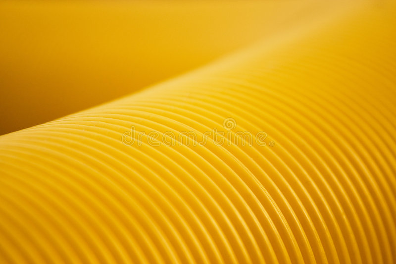 Yellow. Plastic flexible pipe looking like a worm