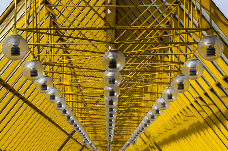 Yellow abstract ceiling. modern architecture with a rhythmic, diagonal forms. Yellow abstract ceiling. A striking example of modern architecture with a rhythmic royalty free stock image