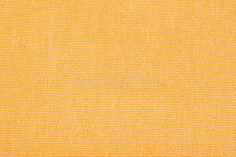 Yellow abstract fabric texture background close-up with copy space for text or image. royalty free stock image