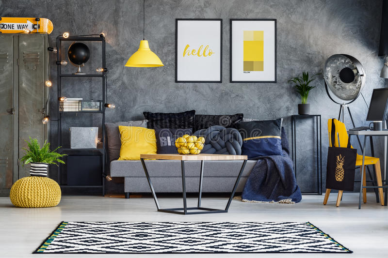 Yellow accents in teenager`s room stock images