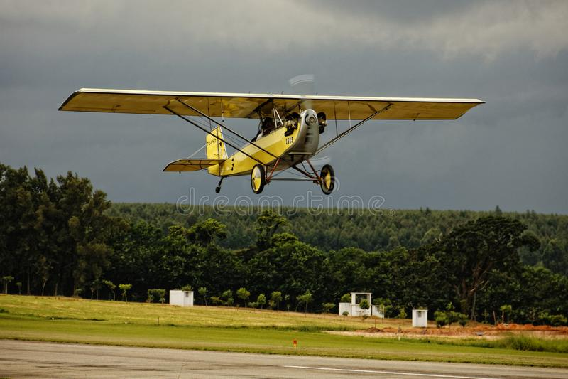 Yellow airplane at take off stock photo