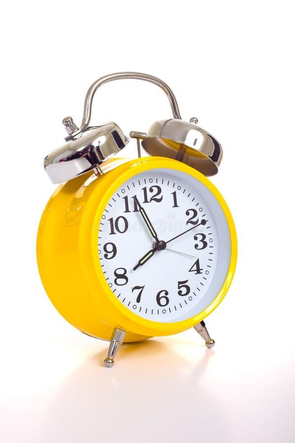 Yellow alarm clock stock photos