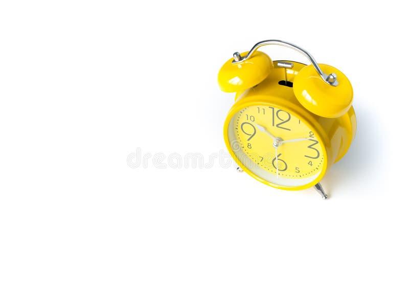 Yellow alarm Clock analog classic retro style on white backgroun royalty free stock photos
