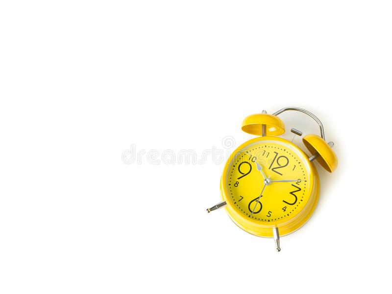 Yellow alarm Clock analog classic retro style on white backgroun. D , Top view and copy space stock photo
