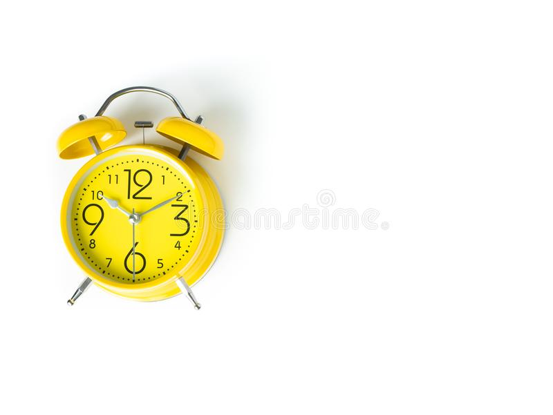 Yellow alarm Clock analog classic retro style on white backgroun. D , Top view and copy space stock photos