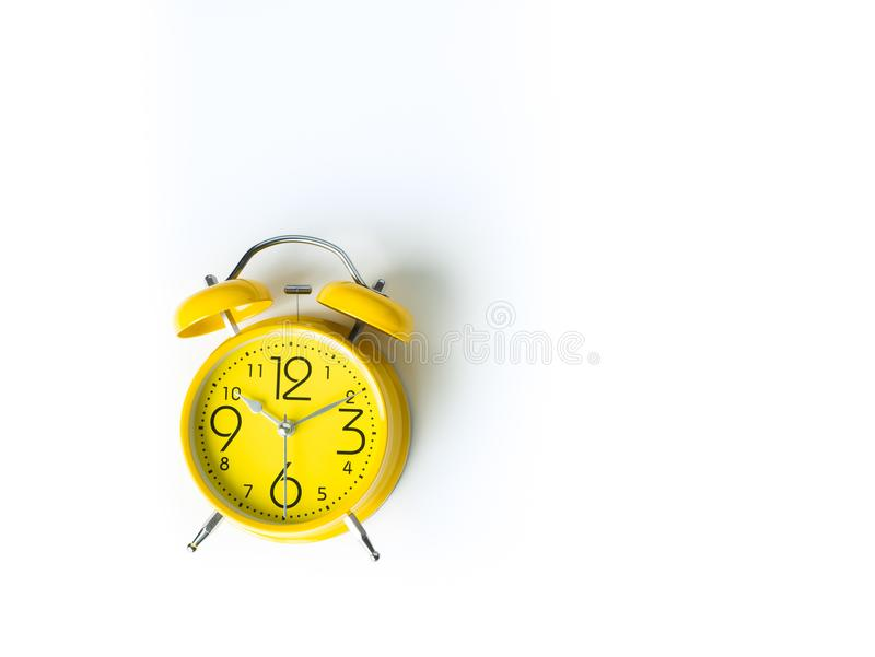 Yellow alarm Clock analog classic retro style on white backgroun. D , Top view and copy space stock images
