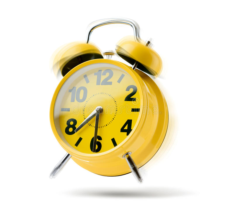 Yellow alarm clock rings in the morning on white background. Time to wake up royalty free stock photos