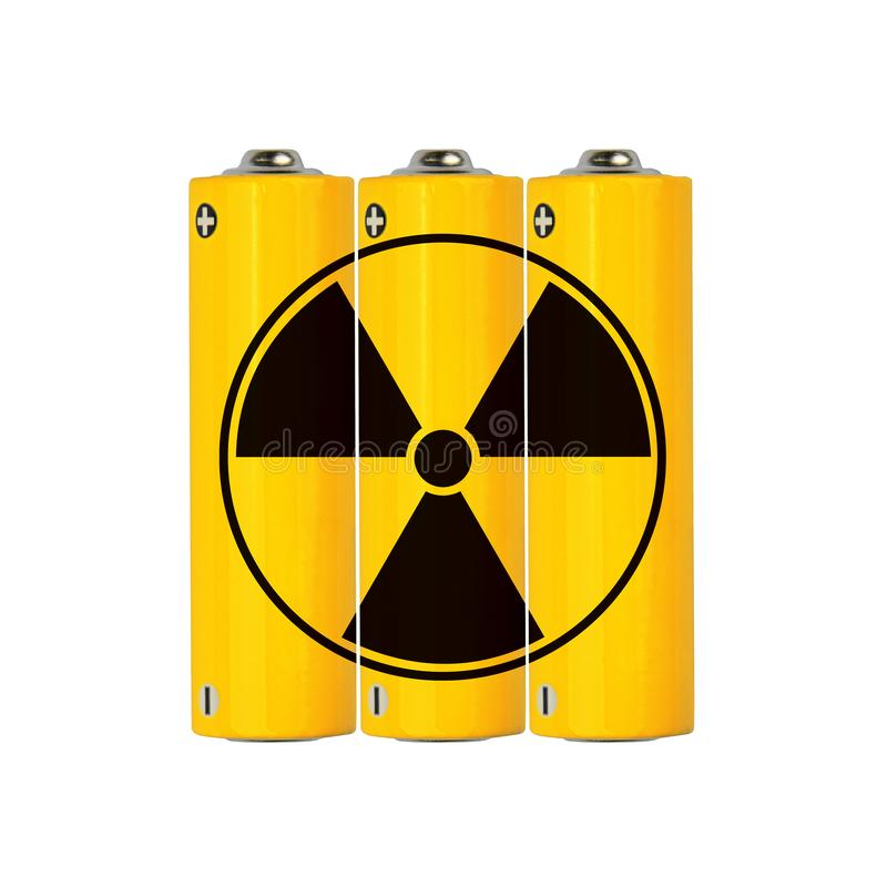 Yellow alkaline AA batteries with radioactive sign. Close up group of vivid yellow alkaline AA batteries with black radioactive danger sign isolated on white royalty free stock photo