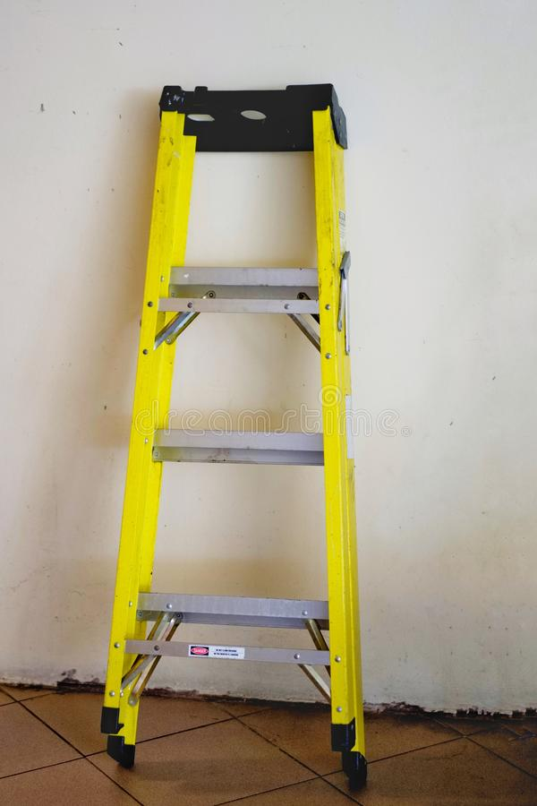 A yellow aluminum ladder. royalty free stock photo