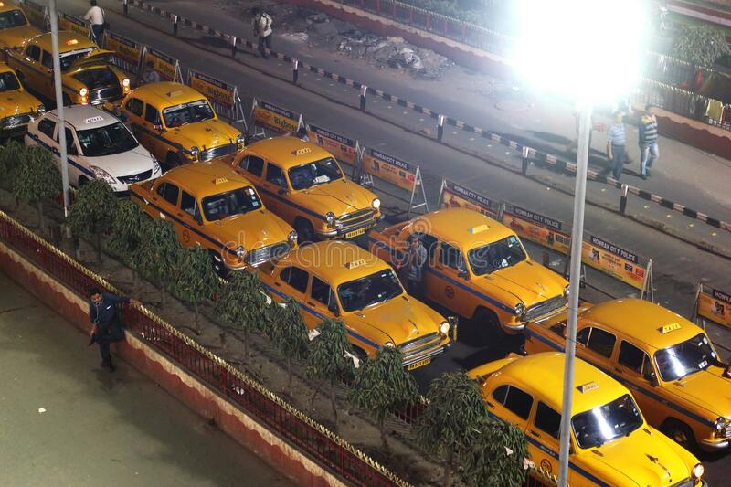 Yellow ambassador taxi cab of Kokata. Yellow ambassador taxi in street of Kolkata at night. Ambassador car is also known as best car for taxi service stock photo