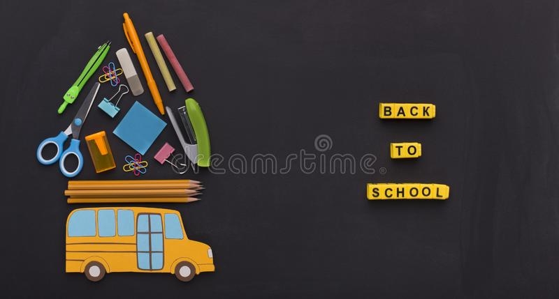 Yellow american bus with stationery on the top on chalk board royalty free stock images