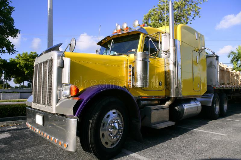 Yellow american truck with stainelss steel. Big yellow american truck in sunny blue sky day royalty free stock images