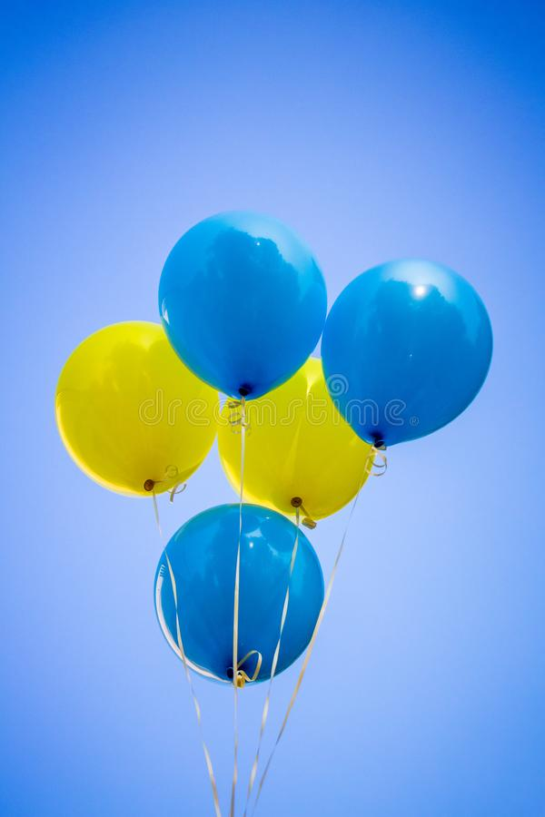 Free Yellow And Blue Balloons On The Background Of The Sky. Ukrainian Stock Photo - 130733180