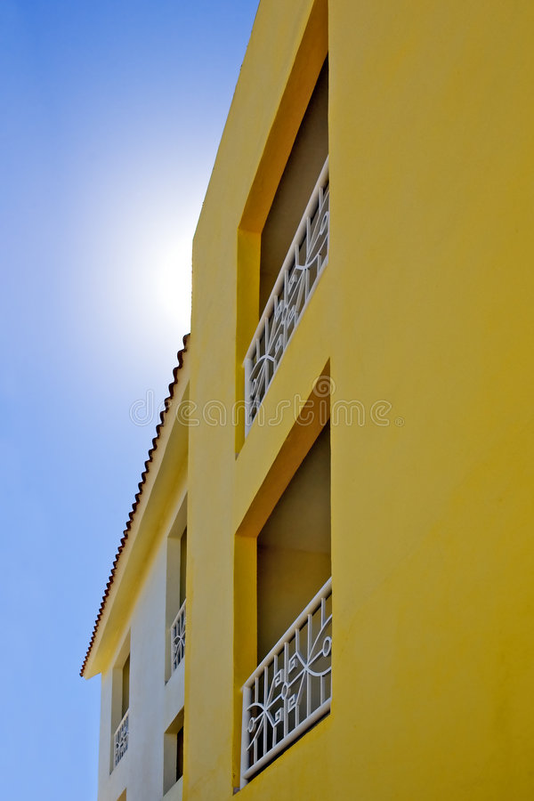 Yellow Apartments and Blue Sky royalty free stock images