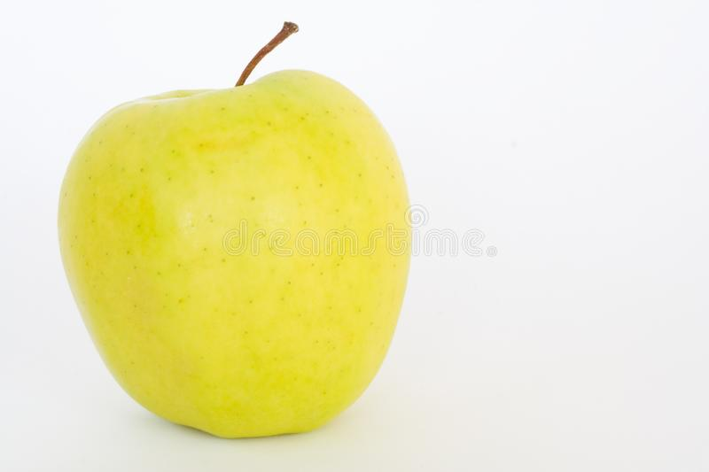Yellow apple. Yellow natural apple isolated over white background royalty free stock images